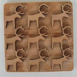 "alder trivet with reindeer design 6.5"" x 6'5"" Made in Sweden"