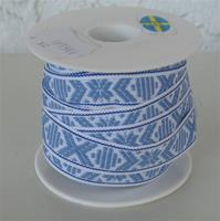 White ribbon with light blue pattern sold by yard