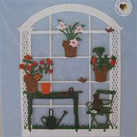 """Cat in Greenhouse"" ""paper cut mobile  Made in Denmark by  Oda Wiedbrecht 7.5"" x 5.5"""